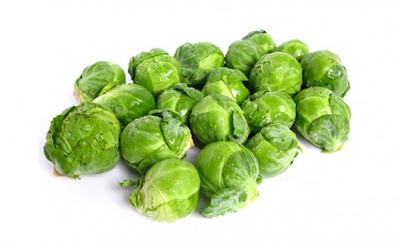 Fresh organic Brussels sprouts on white background